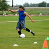 Effingham's Andrew Bingham takes a shot during a drill at a Flaming Hearts soccer practice.
