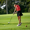 Effingham's Alex Brummer swings and is about to make impact on her tee shot on the sixth hole at Charleston Country Club.