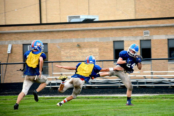 Newton's Mitch Bierman snags a touchdown with two defenders in proximity during the Eagles' media night scrimmage.