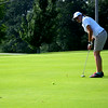 Teutopolis' Ellie Ruholl tracks her putt toward the hole on the fifth green at Charleston Country Club.