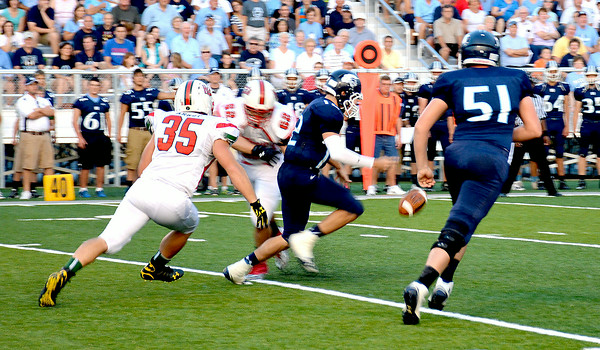 Effingham's Billy Arndt chases down Breese Mater Dei quarterback Sam Toennies in pursuit of a sack  in the Flaming Hearts' opener.