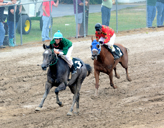 Shane Collins leads Jorge Collazo Sr. in the second thoroughbred race. Collins won the points championship by four points over Collazo Sr.