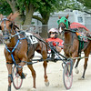 Kyle Wilfong rides Perfectly Clear to the lead in front of a five-horse pack at the halfway point of the Division 1 2- and 3-Year Old Open Pace, a race Perfectly Clear would win at the Effingham County Fair's harness racing.