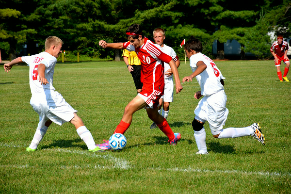 Effingham's Tyler Katz tried to split two defenders during the first half of the Hearts' match against Centralia during the Red and Gold Invitational at Sister City Park in Charleston.
