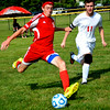 Effingham's Sean Zerrusen attempts a cross during the first half of the Hearts match against Centralia during the Red and Gold Invitational  at Sister City Park in Charleston.