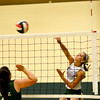 Stew-Stras' Kendall Knop spikes a ball over the net during the Comets' first volleyball practice of the year.