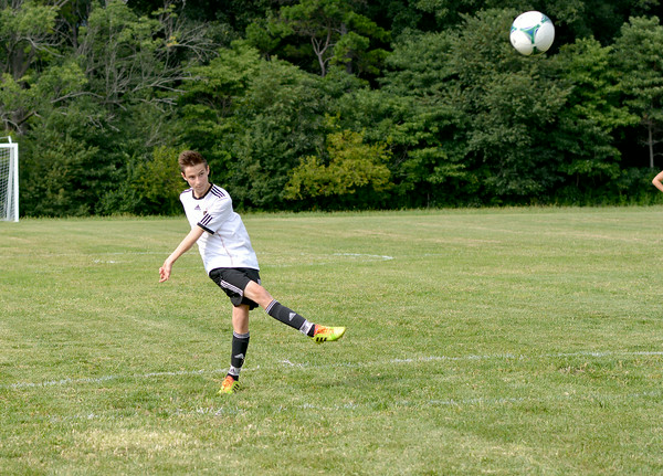 Newton's Felix Scharnbacher watches the ball fly during one of Newton's first-ever soccer practices for the new program.