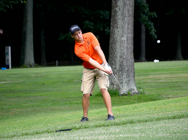 Altamont's Adam Mayhaus chips a ball on to the first green at St. Elmo Golf Club during a dual match with Flora, in the Indians' first action of the season.