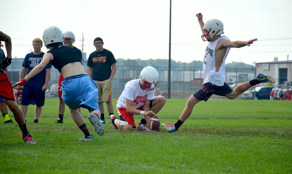 Effingham kicker Michael Carie attempts an extra point during the Flaming Hearts' first day of practice.