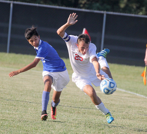 The Stars' Ben Wheatley is fouled by Frankfort's Edgar Flores in Western Boone's 2-1 win on Thursday.