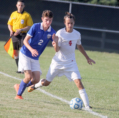 Western Boone's Adam Ellingwood fights off Frankfort's Conner Webb in the second half Thursday afternoon.