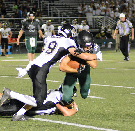 Photo by Debbie Beigh | For the Times Sentinel<br /> Lebanon's Trevor Adler tackles Zionsville's Brock Bishop on Friday night.