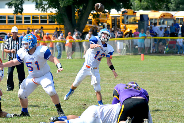 Newton quarterback Tim Weber releases a pass during the Eagles' opener at Georgetown-Ridge Farm.