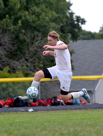 St. Anthony's Ryan Kruger jumps and gathers the ball in during a win over Champaign Centennial.