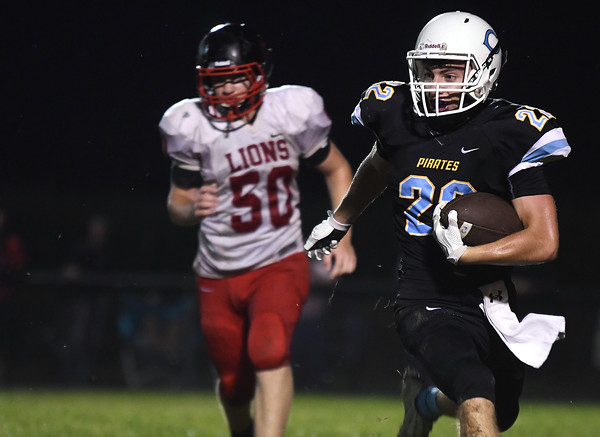 Cumberland's Tannery Kingery looks for a opening during the Pirates' first possession in the second half at Cumberland High School against Decatur LSA.<br /> Chet Piotrowski Jr./Piotrowski Studios