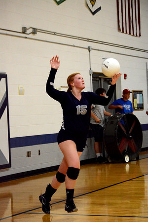 South Central's Kendall Burleyson prepares to serve during the Cougars' two-set loss to Woodlawn.