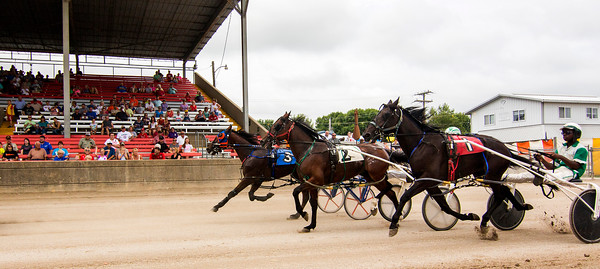 Drivers and their horses take off at the Effingham County Fair.