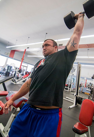 Jordan Donaldson lifts a simulated circus 120-pound barbell at The Zone in Effingham.