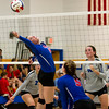 CHBC's Felicia Johnson stretches out to reach the ball during a match against Okaw Valley.