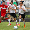 Altamont's Jesus Flores eyes the ball as he goes to goal while teammate Fernando Romo (middle) and Effingham defender Roberto Sotelo watch from behind. Flores scored three goals in his team's 7-1 win over the Flaming Hearts.