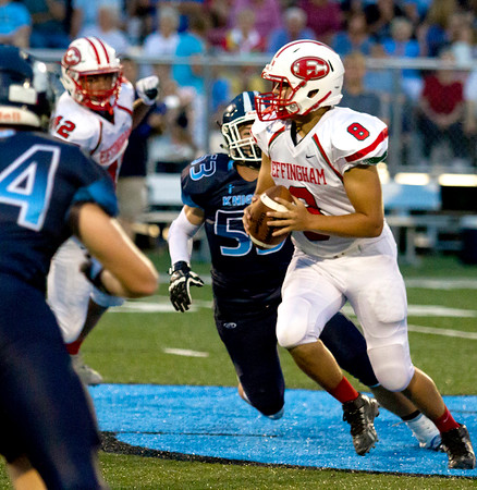 Effingham's Lucas Vasquez steps up in the pocket during the Flaming Hearts' loss at Breese Mater Dei.