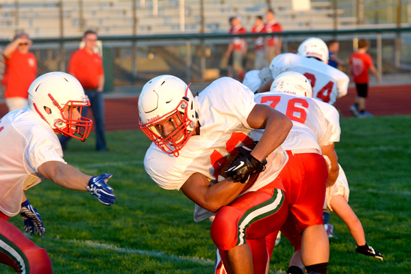 Effingham's Terrence Hill runs the ball downhill during drills at the Buck Bowl.