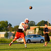 Effingham's Landon Wolfe fires a pass on the first day of football practice.