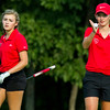 Effingham's Alex Brummer (left) and Keira Hirtzel (right) size up hole number seven at the Charleston Country Club. Together, the two shot a combined 43. That, along with the 45 by Abbi Burgess and Lindsey Stephenson, put Effingham at fifth place in the scramble.