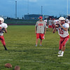 Effingham quarterbacks Lucas Vasquez (left) and Landon Wolfe (right) drop back during passing drills at the Buck Bowl.