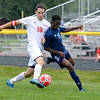 St. Anthony's Jon Blanchette (19, left) fights for position and the ball with Champaign Centennial's Henoc Mondika (19, right) during the Bulldogs' season-opening win at home.