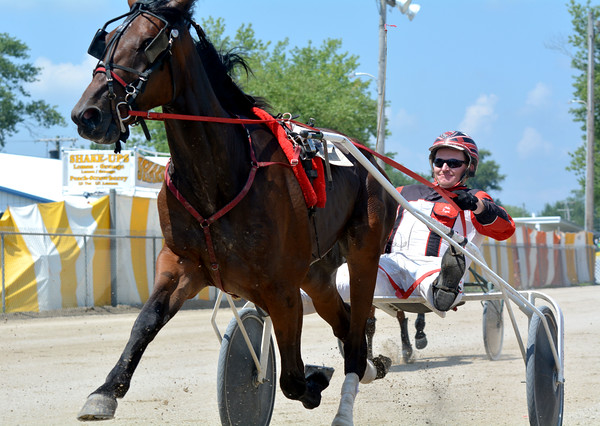 Michael Rogers drives Unkept during the final day of harness racing at the Effingham County Fair.