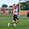 Effingham's Jordan McCabe jumps and reaches for a pass on the first day of high school football practice.
