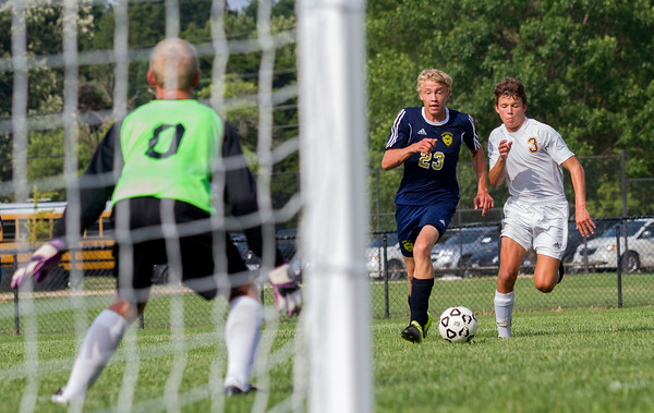 Teutopolis' Joseph Esker dribbles to goal as Monticello's Carter Burgener tries to catch up during the first half of a game at the Red and Gold Invitational in Charleston. Esker had one of the Shoes' six goals as they dropped the Sages 6-0.