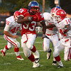 8-24-12<br /> Kokomo High School vs. Plainfield football<br /> Michael Copeland of Kokomo High School runs from Plainfield's defense during the first half of the football game on Friday.<br /> KT photo | Kelly Lafferty