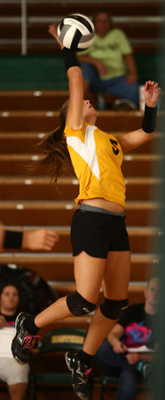8-30-12<br /> Eastern HS volleyball<br /> Eastern's Lizzy Mavrick jumps up to spike the ball at the net during the game against Sheridan on Thursday.<br /> KT photo | Kelly Lafferty