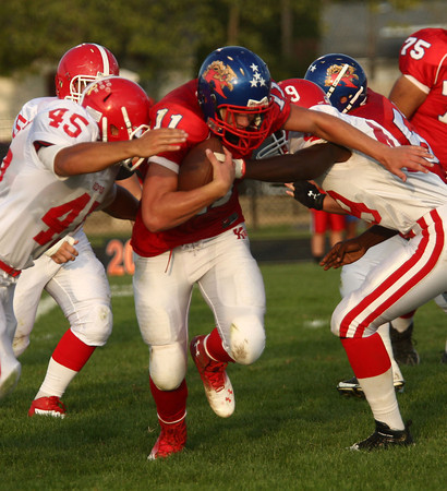 8-24-12<br /> Kokomo High School vs. Plainfield football<br /> Kokomo High School's Taylor Perkins tries to push through Plainfield High School's defense during Friday night's football game.<br /> KT photo | Kelly Lafferty