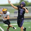 8-13-21<br /> Northwestern vs Pioneer football scrimmage <br /> NW's Jansen Slate throws the ball.<br /> Kelly Lafferty Gerber   Kokomo Tribune