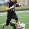 8-13-21<br /> Northwestern vs Pioneer football scrimmage <br /> NW's Cole Cardwell runs the ball.<br /> Kelly Lafferty Gerber   Kokomo Tribune