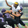 8-13-21<br /> Northwestern vs Pioneer football scrimmage <br /> Pioneer's Cayden Hill gets a pass off before he's tackled.<br /> Kelly Lafferty Gerber   Kokomo Tribune
