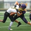 8-13-21<br /> Northwestern vs Pioneer football scrimmage <br /> NW's Braden Hershbergert takes down Pioneer's Cayden Hill.<br /> Kelly Lafferty Gerber   Kokomo Tribune