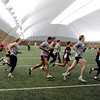 """The Saints run in the CU practice bubble on Thursday.<br /> The St. Kilda Saints, a prominent Australian Rules Football team, is working out in Boulder this winter.<br />  For a video and more photos of practice, go to  <a href=""""http://www.dailycamera.com"""">http://www.dailycamera.com</a>.<br /> Cliff Grassmick  / December 6, 2012"""