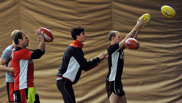 """Saints players perform drills during Thursday's practice.<br /> The St. Kilda Saints, a prominent Australian Rules Football team, is working out in Boulder this winter.<br />  For a video and more photos of practice, go to  <a href=""""http://www.dailycamera.com"""">http://www.dailycamera.com</a>.<br /> Cliff Grassmick  / December 6, 2012"""
