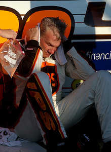 Driver Dale Jarrett is overcome with exhaustion after winning the UAW-Ford 500 at Talladega Superspeedway. © David Bundy