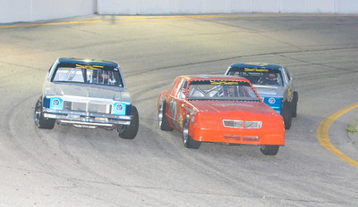 Opening night for Hiway 92 Raceway Park and the Limited Late Models were bumper-to-bumper at the start of their race. Number 12 just narrowly wins the race. Here is #6 on the outside Brent Holiday, #12 Davey Urwin, and #61 Jason Russell.