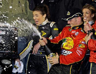 Jamie McMurray, right, sprays champagne in victory lane after winning the Daytona 500 NASCAR auto race at Daytona International Speedway in Daytona Beach, Fla., Sunday, Feb. 14, 2010. (AP Photo/John Raoux)