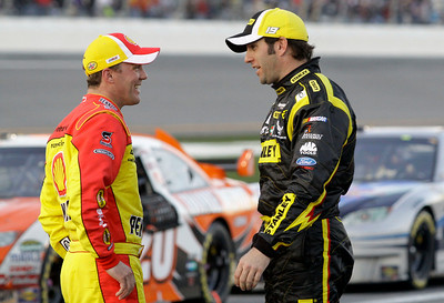 Kevin Harvick, left, talks with Elliott Sadler, right, during the second red flag delay in the NASCAR Daytona 500 auto race at Daytona International Speedway in Daytona Beach, Fla., Sunday, Feb. 14, 2010. (AP Photo/Terry Renna)