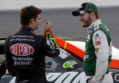 Jeff Gordon, left, and Dale Earnhardt Jr., right, talk during the second red flag delay in the NASCAR Daytona 500 auto race at Daytona International Speedway in Daytona Beach, Fla., Sunday, Feb. 14, 2010. (AP Photo/Terry Renna)