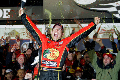 Jamie McMurray celebrates in victory lane after winning the NASCAR Daytona 500 auto race at Daytona International Speedway in Daytona Beach, Fla., Sunday, Feb. 14, 2010. (AP Photo/John Raoux)
