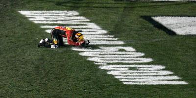 Jamie McMurray kneels on the grass after winning the NASCAR Daytona 500 auto race at Daytona International Speedway in Daytona Beach, Fla., Sunday, Feb. 14, 2010. (AP Photo/David Graham)
