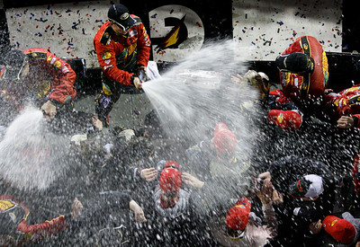 Jamie McMurray, top, sprays his crew with champagne in victory lane after winning the NASCAR Daytona 500 auto race Sunday, Feb. 14, 2010, at Daytona International Speedway in Daytona Beach, Fla. (AP Photo/Orlando Sentinel, Gary W. Green) ** LEESBURG OUT  LADY LAKE OUT  TV OUT  MAGS OUT  NO SALES  **